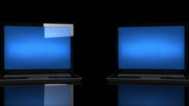 Laptops turn around — Stock Video