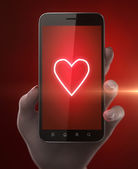 Smartphone with red heart — Stockfoto