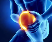 Male knee injured and sprained — Stock Photo