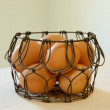 Brown eggs in a wire basket — Stock Photo #61365991