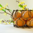 Brown eggs in a wire basket — Stock Photo #61365995