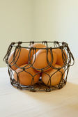 Brown eggs in a wire basket — Stock Photo
