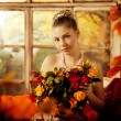 Young woman in vintage dress on autumn porch. Beauty girl in fa — Stock Photo #52156477