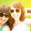 Selfie. Two young trendy girls doing selfie. A couple of friends — Stock Photo #52157879