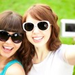 Selfie. Two young trendy girls doing selfie. A couple of friends — Foto de Stock   #52157889