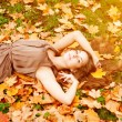 Autumn woman. Beauty young trendy girl in autumn park. — Stock Photo #52158033