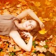 Autumn woman. Beautiful young trendy girl in autumn park. — Stock Photo #52158037