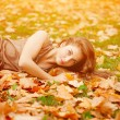 Autumn woman. Beautiful young trendy girl in autumn park. — Stock Photo #52158049