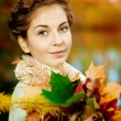 Autumn woman. Beautiful young trendy girl in autumn park. — Stock Photo #52158075