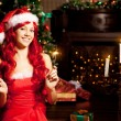Young beautiful smiling santa woman near the Christmas tree. Gir — Stock Photo #52158165