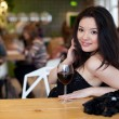 Young beautiful trendy woman in bar. Beautiful Asian girl in a p — Stock Photo #52158745