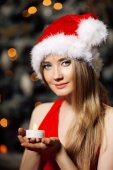 Young beauty smiling santa woman near the Christmas tree. Fashio — Stockfoto