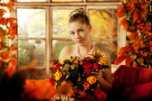 Young woman in vintage dress on autumn porch. Beauty  girl in fa — Foto de Stock