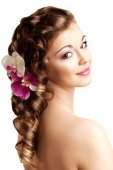 Makeup and hairstyle. Young beautiful woman with luxurious hair. — Stock Photo