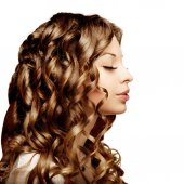 Makeup and hairstyle, curls. Young beautiful woman with luxuriou — Stock Photo