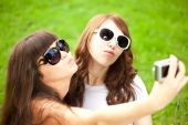 Duckface. Selfie. Two young trendy girls doing selfie. A couple — Stock Photo