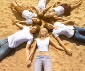 Group young friends enjoying a beach party on vacation. People h — Stock Photo
