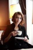 Young beautiful woman in a cafe. Modern trendy blondy girl in re — Stock Photo