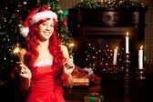 Young beautiful smiling santa woman near the Christmas tree. Gir — Stock Photo
