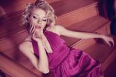 Luxury woman. Young fashionable slim pretty woman in the bedroom — Stockfoto
