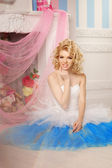 Cute woman looks like a doll in a sweet interior. Young pretty s — Stock Photo