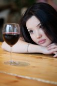 Young beautiful trendy woman in the bar. Beautiful Asian girl in — Stock Photo