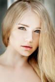 Woman face close up. A pretty young blond trendy. Girl with a be — Stock Photo