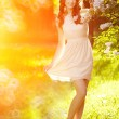 Young spring fashion woman  in spring garden. Springtime. Trendy — Stock Photo #71594797