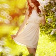 Young spring fashion woman  in spring garden. Springtime. Trendy — Stock Photo #71594877
