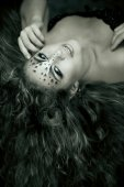 Beauty woman with makeup in snow leopard style. Fashion makeup m — Stock Photo