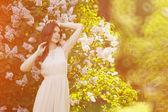 Young spring fashion woman  in spring garden. Springtime. Trendy — Stock Photo