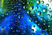 Abstract background texture drops of water and art light on glas — Stock Photo