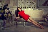 Slim trendy, luxurious, fashion woman in  lux vintage interior.  — Stock Photo
