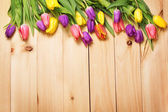 Spring Flowers bunch at wood floor texture. Beautiful Tulips bou — Stock Photo