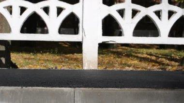 Asphalt paver applying asphalt on the way — Video Stock