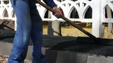 Asphalt paver applying asphalt on the way — Stock Video