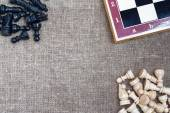 Chess pieces and chess board on sacking — Foto de Stock