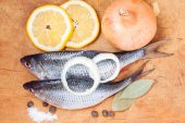 Raw fish with lemon and vegetables — Stock Photo