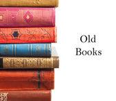 La pile de vieux livres sur fond blanc — Photo