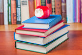 Stack of books on the table and red apple — Stock Photo