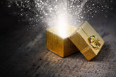 Magical gift with rays and sparks — Stock Photo