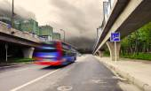High-speed vehicles blurred trails on urban roads under overpass — Stock Photo