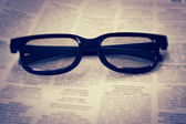 Glasses On Newspaper — Stock Photo