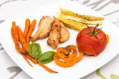 Roasted chicken with backed vegetable — Stock Photo