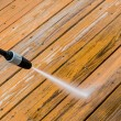 Wooden deck floor cleaning with high pressure water jet. — Stock Photo #57101683