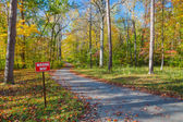 Wrong Way Traffic sign in autumn park — Stock Photo