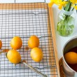 Dyeing Easter eggs natural way with turmeric for mustard - yello — Stock Photo #68428329