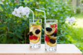 Infused water with  berries and golden kiwi. — Stock Photo