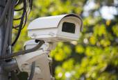 Security surveillance camera in the park — Stock Photo