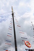 Colored shrouds and mast — Stock Photo